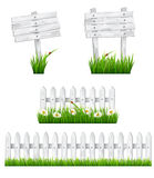 Set of white wooden signs and a fences with grass. Royalty Free Stock Photos