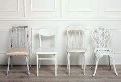 Set of white wooden vintage chairs Stock Photography