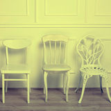 Set of white wooden vintage chairs stock photos