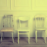 Set of white wooden vintage chairs royalty free stock photography