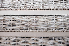 Set of white woven drawers against a wall. Set of three white woven drawers leaning against a wall Stock Photos