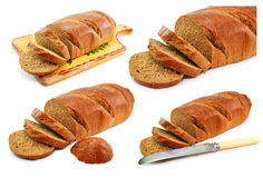 Set of whole wheat breads and tableware isolated. On a white background Royalty Free Stock Photography