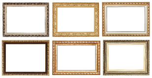 Set of wide golden ancient wooden picture frames Royalty Free Stock Photos