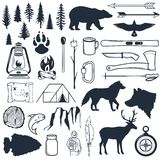 Set of wilderness silhouettes. Hand drawn camping and hiking elements. Collection for summer camp outdoors. Labels. Set of wilderness silhouettes. Hand drawn stock illustration