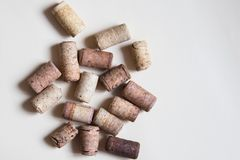 Set of wine cork stoppers on beige background. Top view royalty free stock photos