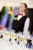 Set of wine glasses with waiter. On blurred background. Shallow depth of field Stock Photos