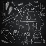 Set of winter camping symbols, signs on chalk board Royalty Free Stock Image