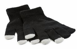 Set of winter gloves with touch pad feature Stock Images