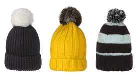 Set of winter hats with pompon. Isolated on white Stock Photography