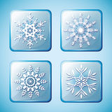 Set of winter icons with snowflakes. Set of winter icons with white ornate snowflakes  on blue background. New Year and Christmas design elements. Vector Royalty Free Stock Photos