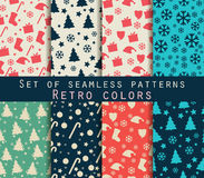 Set of winter seamless patterns. Retro colors. Royalty Free Stock Image