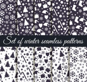 Set of winter seamless patterns with snowflakes, Christmas trees and toys. Christmas seamless patterns. Royalty Free Stock Images