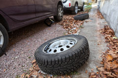 Set of winter wheels and tyres replacing on car Royalty Free Stock Images
