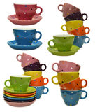 Set With Colorful Cups And Saucers Stock Photos