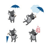 Set with wolves. Vector autumn set with four cute cartoon wolves in different poses, umbrellas and autumn leaves Royalty Free Stock Photography