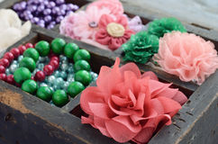 Set of woman's accessories in old wooden box Royalty Free Stock Images
