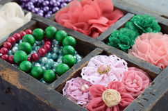 Set of woman's accessories in old wooden box Royalty Free Stock Photos