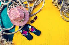 Set of Woman`s Things Accessories to Beach Season Straw Beach Woman`s Hat Yellow Background Flat Single. Copy space. Set of Woman`s Things Accessories to Beach Stock Photos