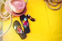 Set of Woman`s Things Accessories to Beach Season Straw Beach Woman`s Hat Top View Yellow Background Flat Single. Top view for copy space some idea your create Stock Photos