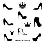 Set of woman shoes silhouettes with crowns. Black female fashion icons  on white. Vector illustration Stock Images