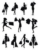 Set of woman shopping silhouettes Stock Images
