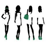 Set of women black silhouettes,. Four silhouettes of women Royalty Free Stock Photos