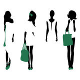 Set of women black silhouettes,. Four silhouettes of women Royalty Free Stock Images