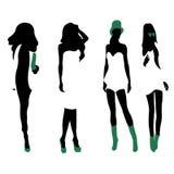 Set of women black silhouettes,. Four silhouettes of women Stock Photos