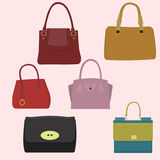 Set of Women handbags. Set icons of Women handbags and travel bag in sketch style Stock Photos
