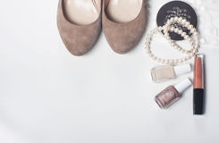 Set of women's  accessories and cosmetics on white background. Royalty Free Stock Images