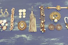 Set women`s jewelry on wooden background. royalty free stock photo