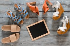 Set of womens shoes wedges, heels and flat sandals on grey woo. Den background. Spring summer collection. Flat lay. Fashion concept. Template for online store Royalty Free Stock Images