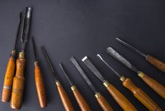 Set of wood chisel for carving wood, sculpture tools on gray background. Set of wood chisel for carving wood, sculpture tools on gray stock photos