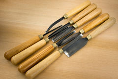 Set of wood chisel for carving wood, sculpture tools. On wooden background royalty free stock photos