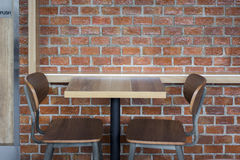 The set of wood seat and table. With brick wall pattern background Stock Images
