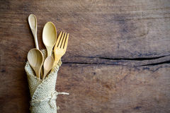 Set of wood spoon and fork on wooden table Stock Images