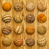 Set of wooden balls against veneer. A set of wooden balls against veneer - collage Stock Photo