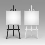 Set of Wooden Black White Easels with Canvases Stock Photos