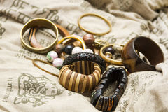 Set of wooden bracelets on a design pillow Royalty Free Stock Photo
