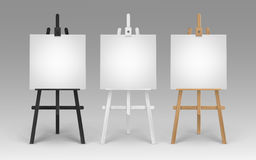 Set of Wooden Brown Black White Sienna Easels with Mock Up Empty Blank Square Canvases Isolated on Background Stock Photos