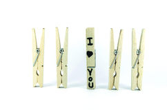Set of wooden clothes pins with love Stock Photography