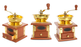 Set wooden coffee mill with gold-plated metal isolated on white Royalty Free Stock Photo