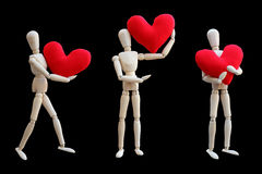Set of Wooden dummy holds red heart Stock Photos