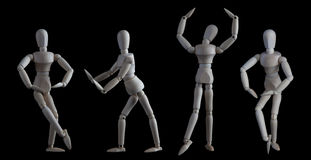 Set of wooden figurines in elegant dance move poses isolated on Royalty Free Stock Photography