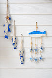 Set of wooden fish, hanging on wall Stock Image