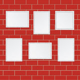 Set of wooden frames  on the wall of red bricks Stock Photos