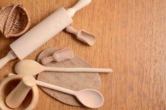 Set of wooden kitchen utensils Stock Photos