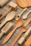 Set wooden kitchen utensils on wooden table. Stock Photography
