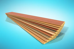 Set of wooden laminated construction planks isolated on blue  Royalty Free Stock Image