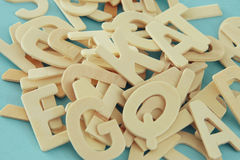 Set of a wooden letters of the English alphabet. On wooden blue background Royalty Free Stock Photography